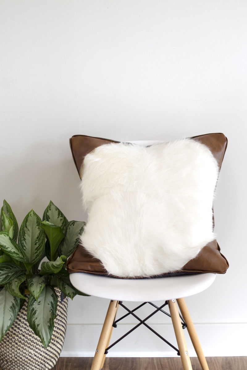 DIY fur pillow with leather accents
