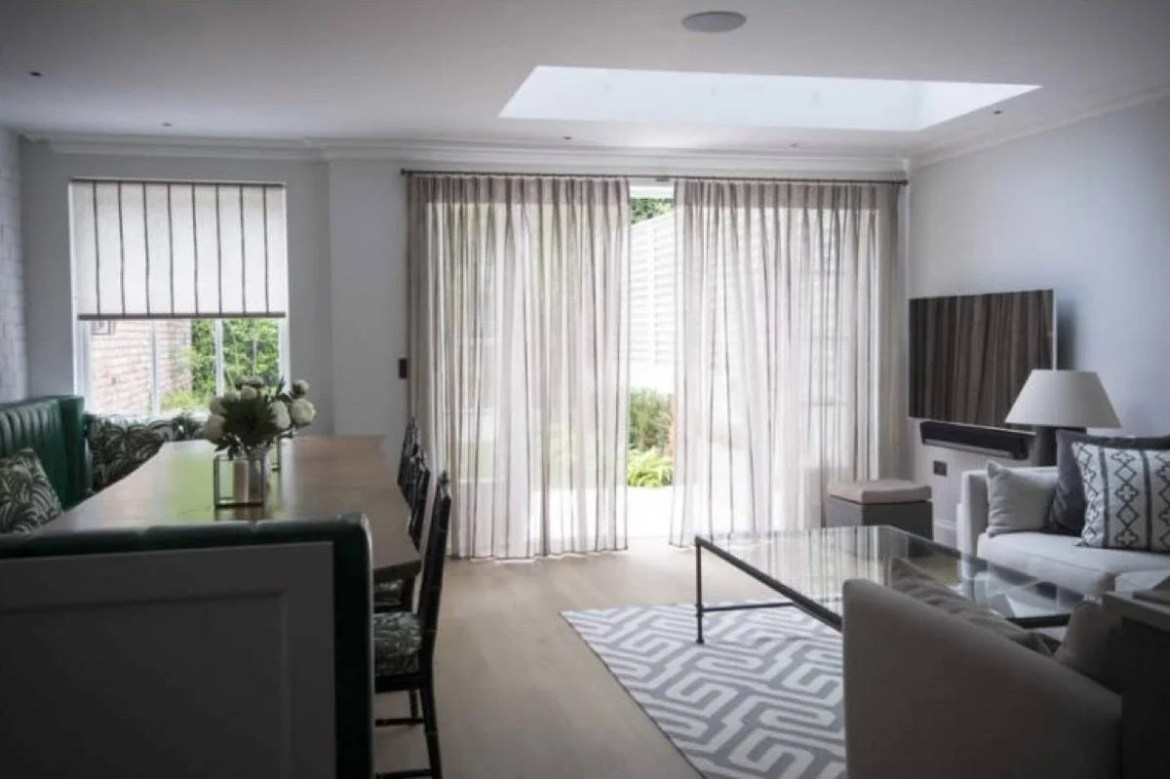 Sheer floor-to-ceiling curtains