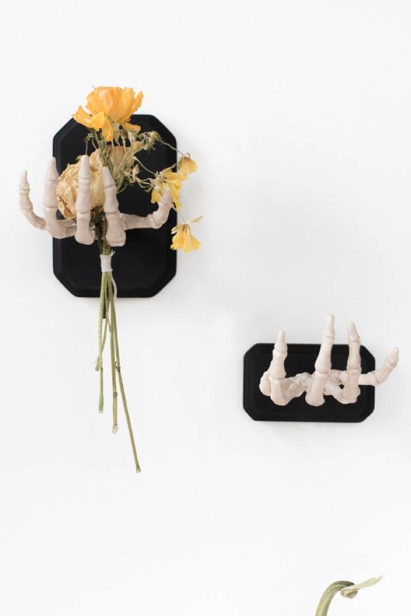 Wall-mounted skeleton hands