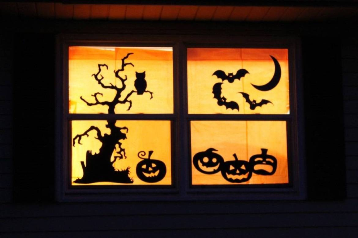 Paper silhouettes in window