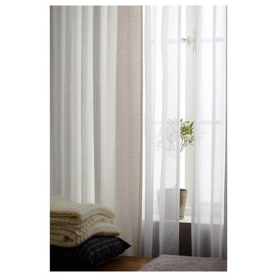 Long white curtains are a staple of Scandinavian style