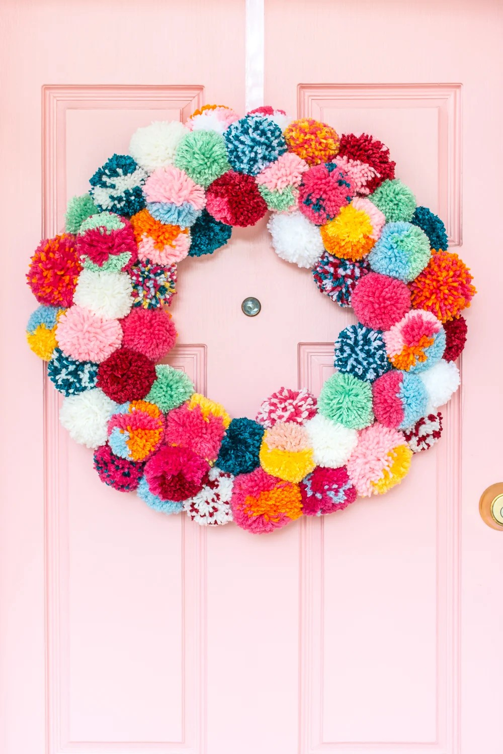 Bright and colorful DIY boho holiday pom-pom wreath