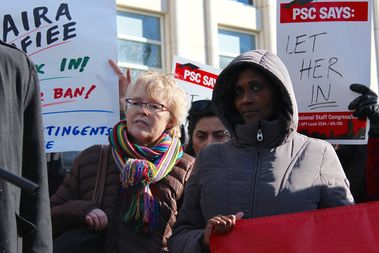 Barbara Bowen, left, stands with members of the staff union at CUNY, Professional Staff Congress, at a rally for their member Saira Rafiee, an Iranian graduate student unable to come back to the United States to study due to President Trump's recent travel ban.