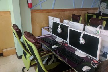 Yangpu Fan, 19, of Flushing, was stabbed in the torso after a fight over these computers at K&D internet cafe, police said.