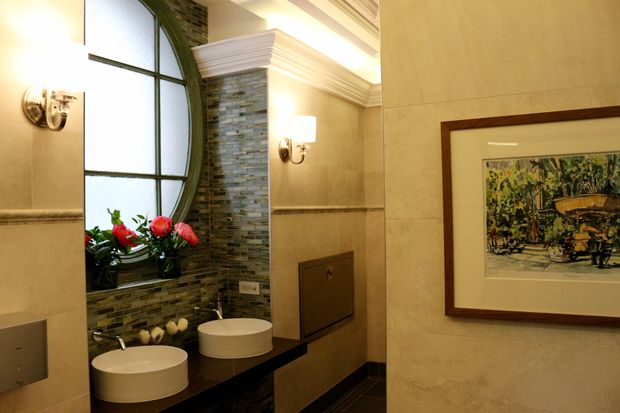 """The new restrooms have """"plein air"""" paintings, new floor and wall tiles and temperature controls."""