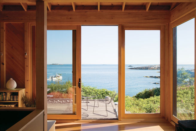 <br /><br /><br /><br /> A green island getaway 20 miles off the coast of Maine features a modest back porch with a remarkable ocean view. Photo by: Eirik Johnson<br /><br /><br /><br />