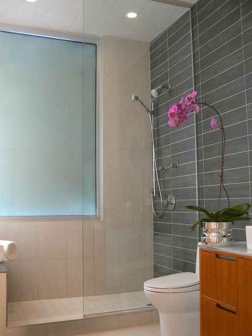 <br />   Master Bathroom<br /> Summer sunshine streaming through the east-facing third-floor windows warms the porcelain tiles in the master bathroom, designed with custom vanities and drawer pulls.<br /> Photo by Morlen Sinoway<br />