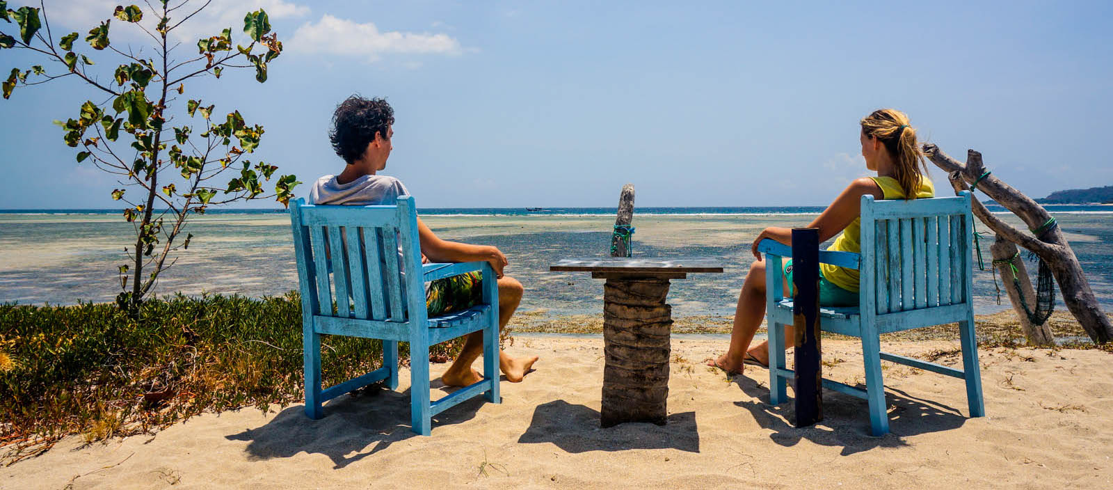 Sandra and Peter sitting on a beach in Gili Air