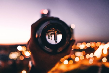 City at night seen through a camera lens