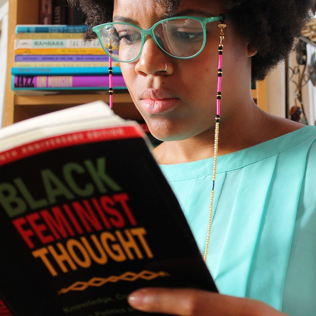 Image result for Black girl with glasses reading a book