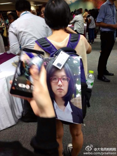 In November 2014, since Zheng Churan (Datu) was denied exit by the Chinese customs, her friend carried a large photo of Zheng and protested on Zheng's behalf  at the Beijing+20 CSO Forum in Bangkok, Thailand. (Photo courtesy of Zheng's weibo)
