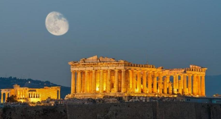 Acropolis of Athens with moon shining in background