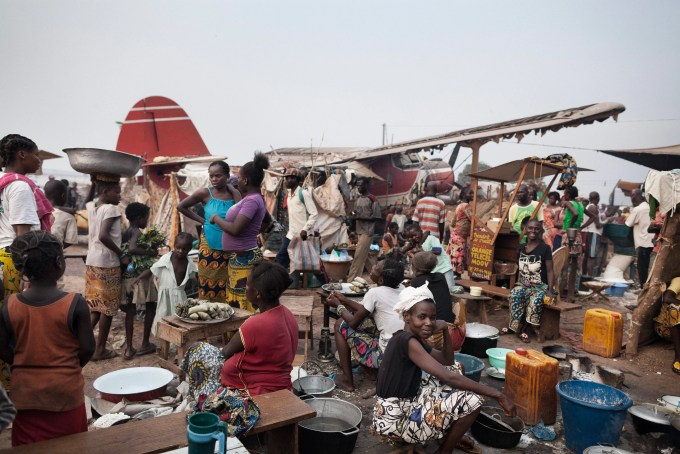 Hundreds of internally displaced people gather at Bangui's M'poko International Airport in the Central African Republic.