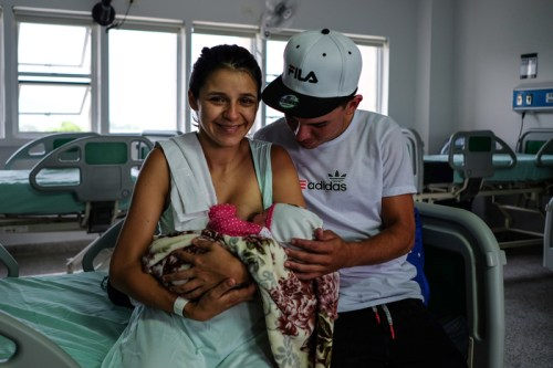 Maria Abarracin, 20, and her husband Mario Barajas hold their newborn baby Hilary at the Erasmo Meoz University Hospital in Cúcuta.