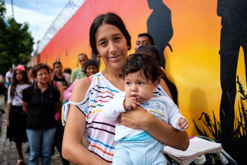 Roxana Bautista, 20, holding her six-month-old son, Keyner, at a health centre in La Parada, Cúcuta.