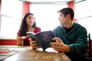 A couple studies the Book of Mormon together at their kitchen table to learn about Jesus Christ