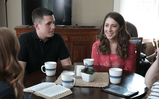 Natalie and Ryan sit at their kitchen table to learn about the word of wisdom