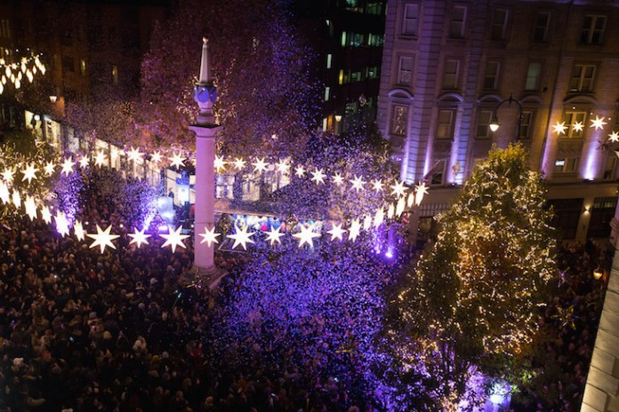 Star-shaped Christmas lights over Seven Dials in Covent Garden, London
