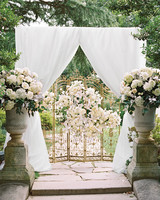 59 Wedding Arches That Will Instantly Upgrade Your Ceremony   Martha     White Canopy and Gold Gate Wedding Arch