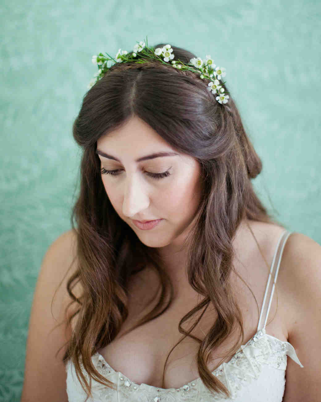 medium length wedding hairstyle with wax flower accents