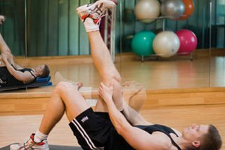 Picture of a man performing a sciatic mobilising stretch