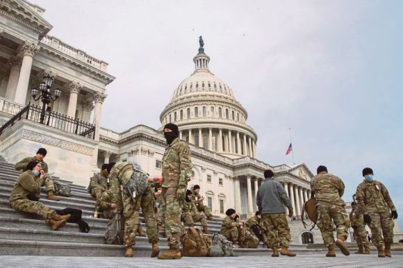 Members of the New York National Guard  on the East Front of the US Capitol in Washington, DC. on Monday following the attack on the Capitol last week as lawmakers worked to certify Joe Biden as the next president. EPA PIC