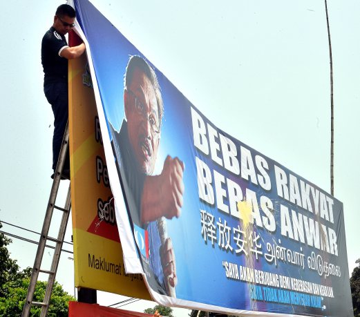Image result for putting up billboards in support of Anwar