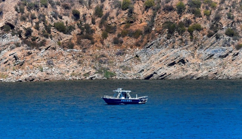 "A patrol boat is seen on Lake Piru in the Los Padres National Forest, Ventura County, California on July 9, 2020 as the search continues for actress Naya Rivera, who was reported missing after going boating with her son on July 8. - ""Glee"" star Naya Rivera is missing and feared drowned at a California lake, where divers, patrol boats and helicopters resumed their search for the US actress on June 9. (Photo by Frederic J. BROWN / AFP)"