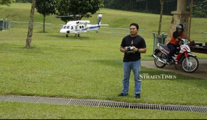 Mohd Irfan operating a radio-controlled helicopter aero-model. - NSTP/ courtesy of Lt Col Muhammad Haris Asmuni