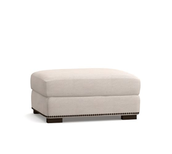 turner upholstered ottoman with nailheads
