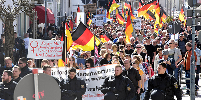 Protesters in Kandel, Germany, demonstrate over migration politics and domestic security in April. (Uli Deck/Picture Alliance via Getty Images)