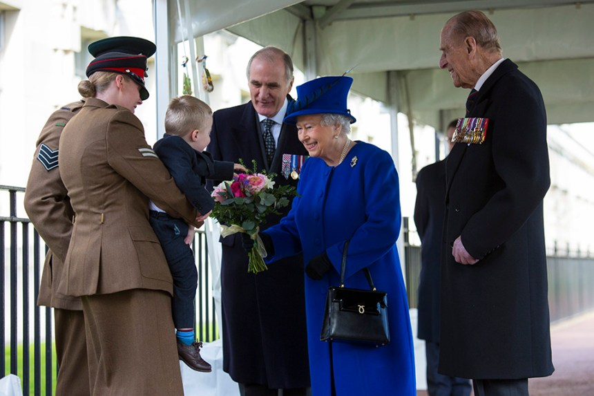 HM The Queen presented with a posy by two-year-old Alfie Lunn. Crown Copyright.