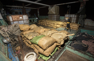 Parcels of seized narcotics lay on the deck of the smuggling vessel.