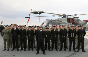 847 Naval Air Squadron stand to attention next to one of two Wildcat helicopters. They have deployed for five months with the Jeanne D'Arc. Crown Copyright.