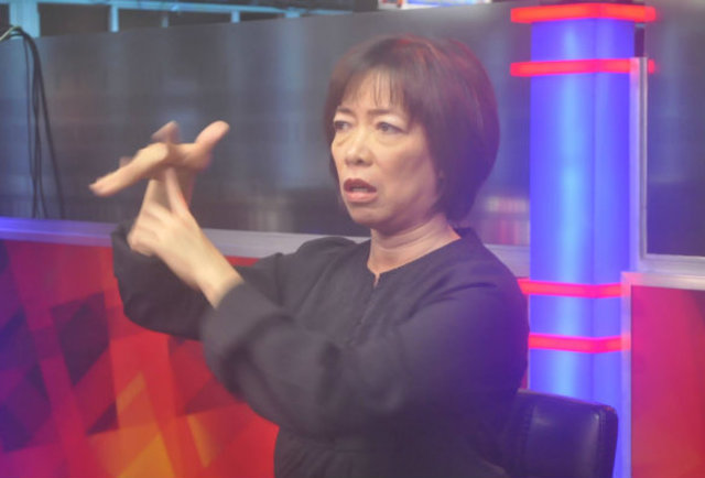 BRIDGING THE GAP. The late Liza Presnillo in one of her many sign language interpretation engagements for TV.