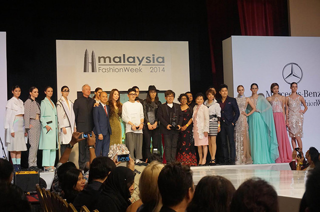 WINNERS. The awardees pose with designer Jimmy Choo, the organizers of the event, and the models wearing their creations