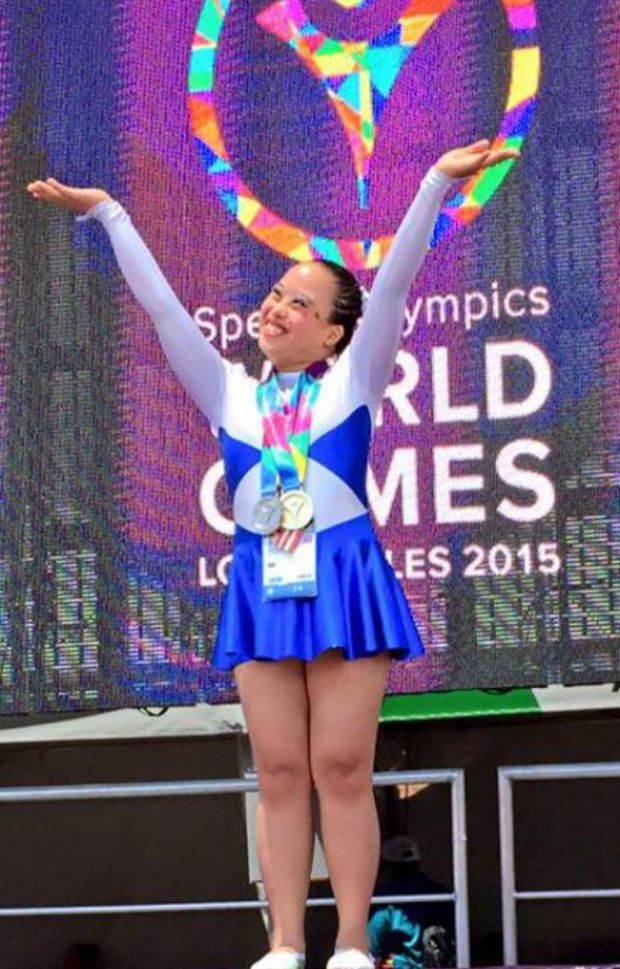Tanya Denamarca from Iloilo wins the Philippines' first gold medal for Photo by Steve Angeles