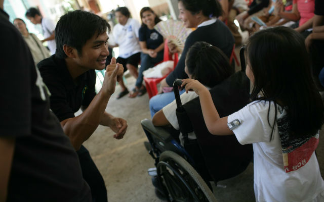 REACHING OUT. GSVP executive director John Paul Maunes talks to a girl from one of their communities using sign language. All photos from GSVP  GSVP