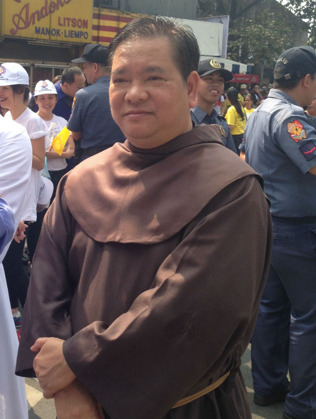 Fr Willy Benito, OFM, brings his parishioners to Luneta to see the Pope