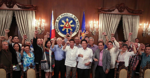CLENCHED FISTS. President Rodrigo Duterte joins communist rebels in their signature gesture – the raised clenched fist. He has a similar gesture – a fist bump – that has become both popular and notorious worldwide. Malacañang photo