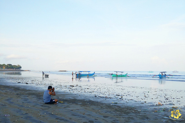AT REST. Early morning low tide at Kuta beach