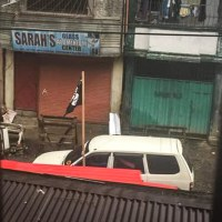 Philippine Terrorist Maute Group raises the ISIS flag as they roam the streets of Marawi City, Philippines