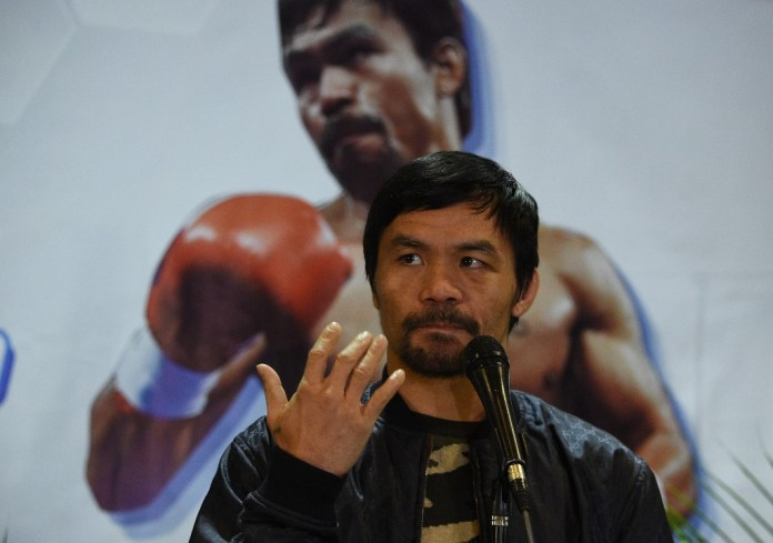 UNDERDOG. The 40-year-old Manny Pacquiao thinks he can beat Keith Thurman in the same way he disposed of Oscar De La Hoya in 2008. File photo by Ted Aljibe/AFP