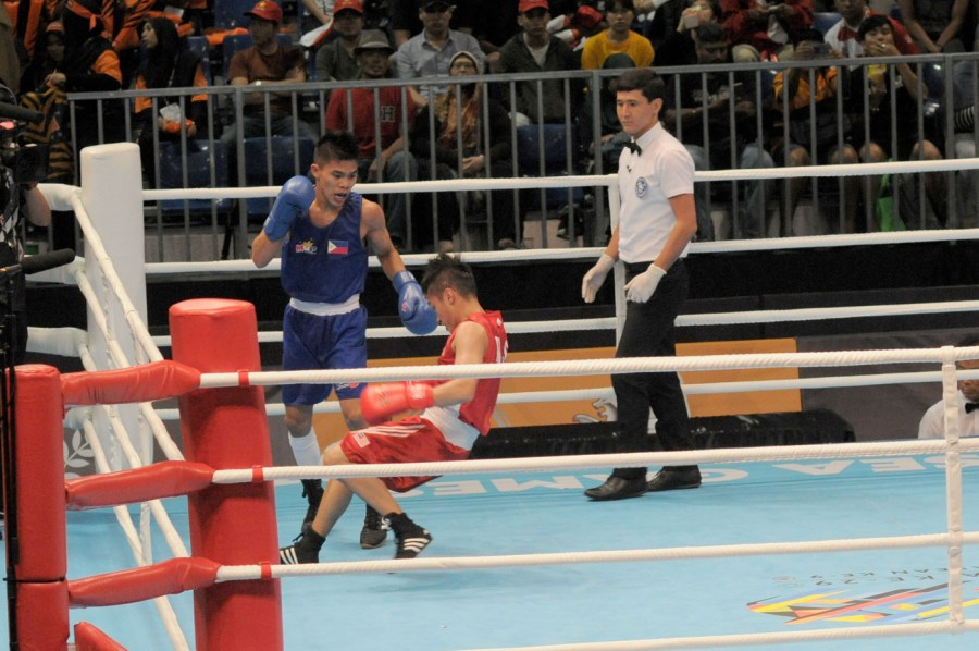 SEA Games boxing Filipino boxer Carlo Paalam connects with a right hand that puts Malaysia s  Muhamad