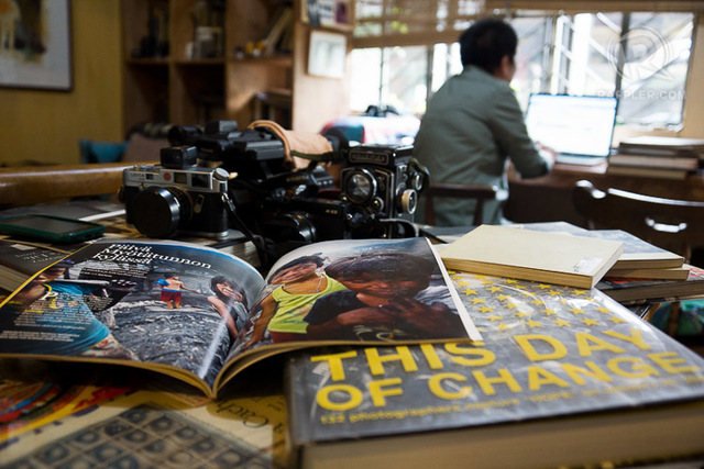 WORKPLACE. On the table where Nana dines you can find books, prints, mementos side by side with the various cameras ready to be picked up anytime. Photo by A.g. De Mesa/Rappler