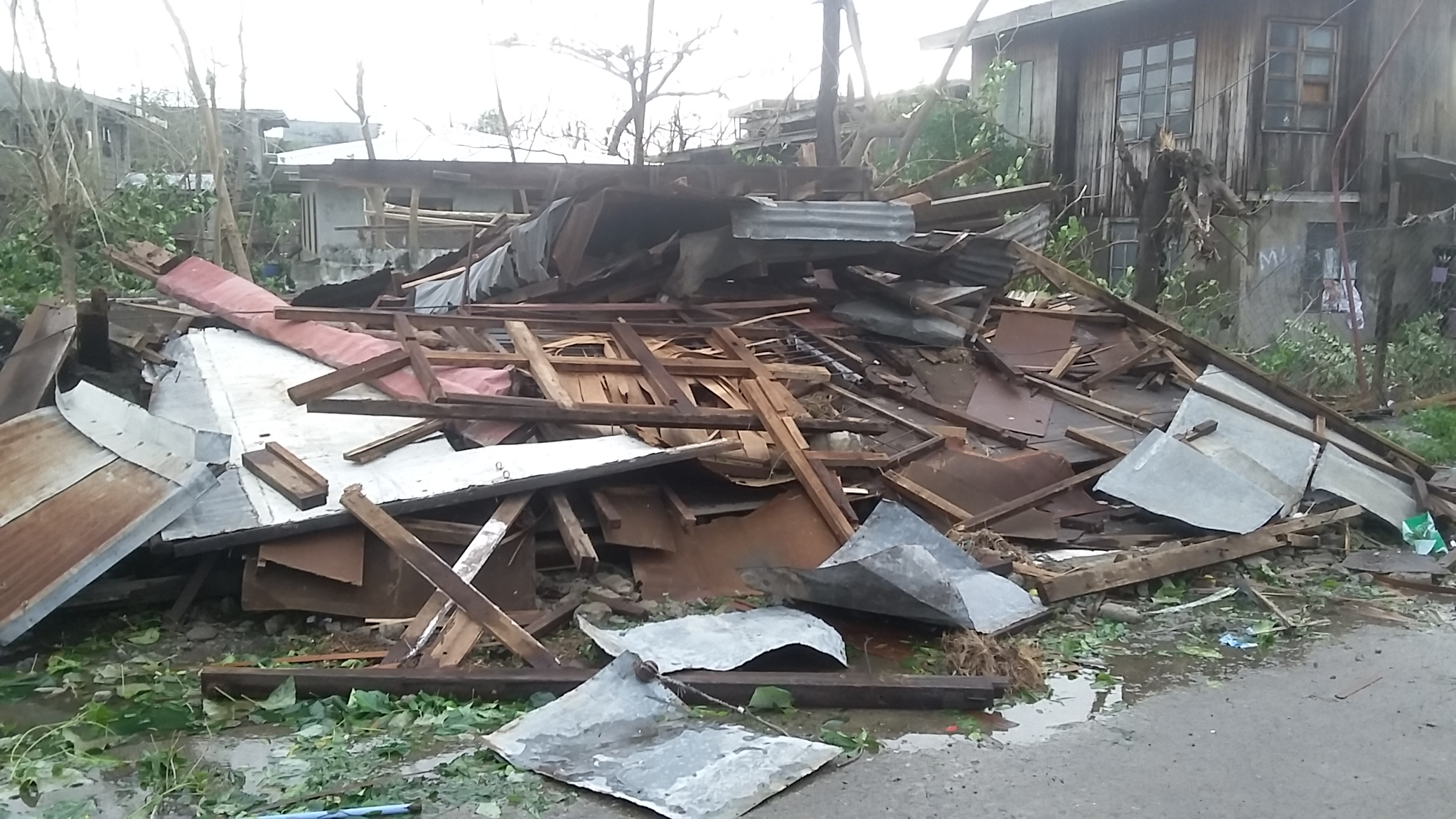 damaged houses in the aftermath of Haima/Lawin