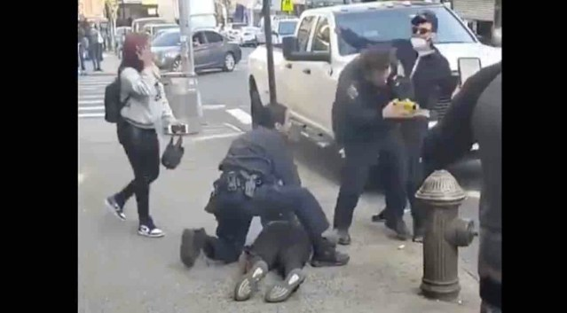 Thug wearing medical mask sucker punches NYPD officer from behind — and onlookers cheer for culprit as he runs away
