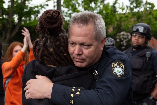 A sheriff marching with protesters in Flint was among the hopeful images from a violent, destructive weekend