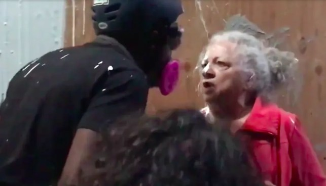 Rioters splash paint on elderly woman, get in her face when she stands up to their police precinct attack: 'This isn't your world anymore!'