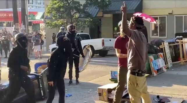Black man chants 'All Lives Matter!' as white Seattle leftists try getting him to stop. But he's had enough: 'F*** Black Lives Matter!'